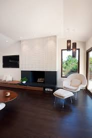 pretty fireplace surround kits in family room midcentury with wood look porcelain tile floor next to fireplace surround alongside low basement ceilings and