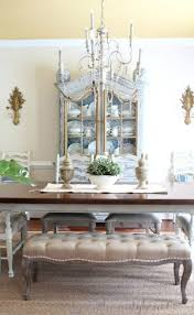 french country dining room painted furniture antiques upholstered bench tufted bench blue toile seagr rug vine ethan allen sconces