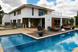 l shaped swimming pool designs with black outdoor lounge chairs furniture for most popular exterior house color schemes