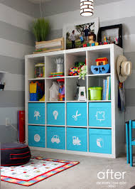 pretty ikea toy storage in white and blue nuance filled with kids goods and  frame above