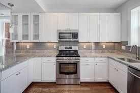 white cabinets grey backsplash kitchen subway tile