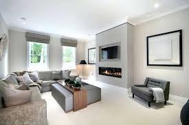tv over fireplace modern living room ideas with fireplace and living room contemporary with grey armchair