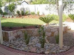 The dry stream - river rock garden edging ideas