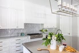 kitchen cabinet corbels with marble backsplash