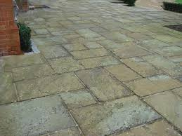 york stone flags. a terrace using reclaimed york stone paving slabs flags
