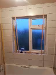 tiling around the window shower bath