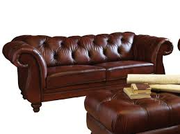 dark brown color modern two seater leather tufted sofa with wingback and wooden legs plus ottoman table ideas