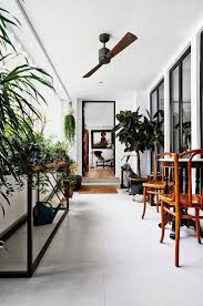 Interior designers: ICIA Type of home: Two adjoining three-room HDB flat  The unassuming white aluminium fins on the side of the terrace provide  privacy ...