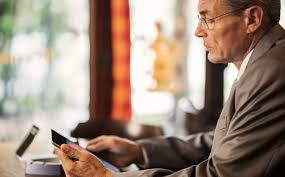 the future of accessibility innovation foreign policy side view of mature businessman in the bar using digitall tablet url