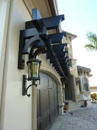 full image for a trellis over garage door adds nice architectural feature to home weeasy plans