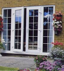 exterior wooden doors with glass panels and painted with white color for house with brown exposed brick wall and outdoor mounted flower box ideas
