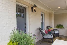 white craftsman front door. Craftsman Front Door With Exterior Stone Floors, Painted Brick Wall, Outdoor Wicker Furniture, White I