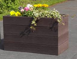 Bramble recycled plastic planter situated in a park