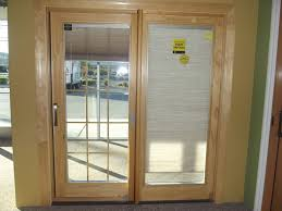 pella wood clad french sliding patio door with blinds between the glass