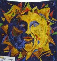 People's Choice Awards & Second Prize, Wall Quilts. Pattern Name: Sun Portrait by Susan Carlson.  Wall Quilt 22 x 22. Machine Appliquéd, Machine Quilted Adamdwight.com