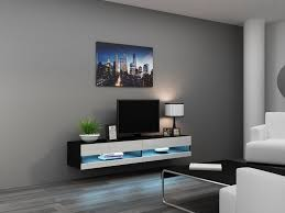 wall mounted tv stand with storage cabinrt made of wooden in black color scheme with white