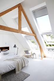 Slanted Roof Bedroom Swooning Over The Oversized Slanted Windows Triangular Beams In
