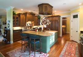 wood kitchen with green painted island and butcher block counter