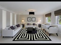 modern living rooms design adorned with black and white area rugs
