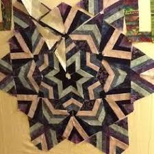 Kaleidoscope, from Ricky Tims' book. Border is from the EQ library ... & trying Ricky Tims Kool kaleidescope pattern Adamdwight.com