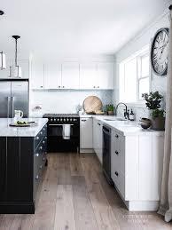 modern scandi inspired white farmhouse design whitewashed kitchen with natural wood floors