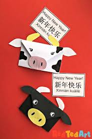 Celebrate the year of the ox with this cute paper cup and ball craft! Easy Cow Origami Envelope Year Of The Ox Red Ted Art Chinese New Year Crafts For Kids Chinese New Year Crafts New Year S Crafts