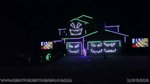 an incredible light show perfectly synchronized to monster mash and ghostbusters
