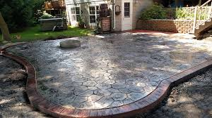 shaped colored and stamped concrete patio with fire pit