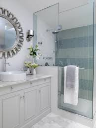 glass shower room with silver framed mirror using excellent bathroom wall removal ideas with striped tiles