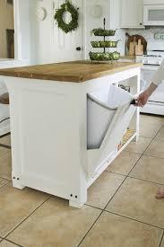 diy plans kitchen island trash storage wood butcher block countertop white table tile floor ceramic backsplash stove door storage movable portable