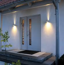 exterior adorable wall lamp side unusual door closed black doormat on white floor plus green