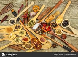 spices on wooden spoons s of exotic spices seasoning food aromatic spices