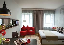 decorating a studio apartment on a budget. Apartment Apartments Decorating Ideas Cheap Small Bedroom With Budget Decoration And Red Couch White Mattress Black Pendant Lamp A Studio On E