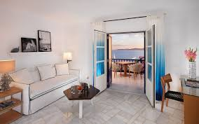 furniture to separate rooms. The Living Room With Sofa Of Mykonos Grand Sea View Suite Separate Furniture To Rooms L