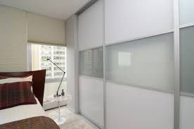 dazzling large frosted glass sliding door design feature cream canvas blinds and adjule lamp in modern