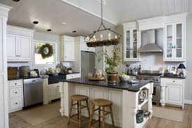 Elegant kitchen photo in Detroit with beaded inset cabinets, stainless  steel appliances, marble countertops
