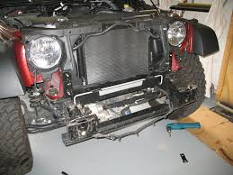 mopar jeep wrangler jk bumper installation jeepfan com it s helpful to have someone hold the bumper slightly away while the lights are unplugged and the wiring clips are removed tie the wires out of the way
