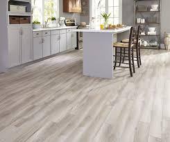 large minimalist u shaped dark wood floor and gray floor eat in kitchen photo