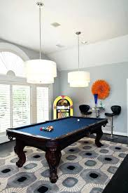 rug under pool table a bold graphic blue and gray rug lays foundation for rug size
