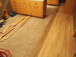 how to lay hardwood flooring over linoleum