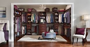 attractive master bedroom closet ideas with round blue ottoman and small chandelier medium size