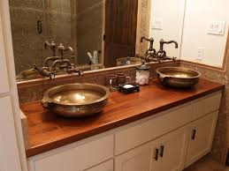 vessel sinks are free standing sinks that sit directly on the surface of the wood