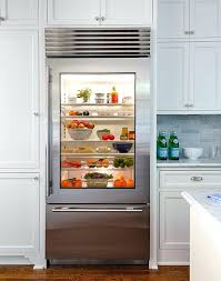 residential glass door refrigerator chic kitchen boasts cabinets surrounding a front and freezer drawer for