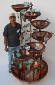 roberto marquez with a 7 bowl 7 foot waterfall fountain