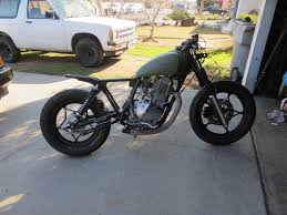 81 gn400 build cafe brat did some work on the tank and primered it i think i might keep it this color looks pretty cool