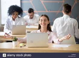 Image Executive Calm Smiling Millennial Woman Practicing Office Meditation In Co Alamy Calm Smiling Millennial Woman Practicing Office Meditation In Co