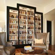 lighting for bookshelves. lighting for bookshelves family room transitional with white walls crown molding black door