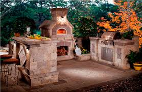maximal cost outdoor kitchen with fireplace