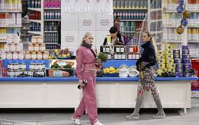 chanel tracksuit. picking up dinner: tracksuit clad models browsed the foodie displays and picked a few chanel
