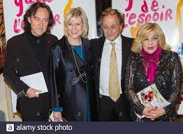 Chantal Ladesou and her husband Michel Ansault, Nicoletta and her husband  Jean-Christophe Molinier during the 27th L'Espoir Gala of the Cancer League  at the Champs-Elysees Theate in Paris on October 22, 2019.